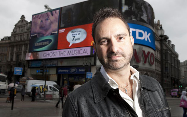 Paul Kieve stands as a magician in Piccadilly Circus