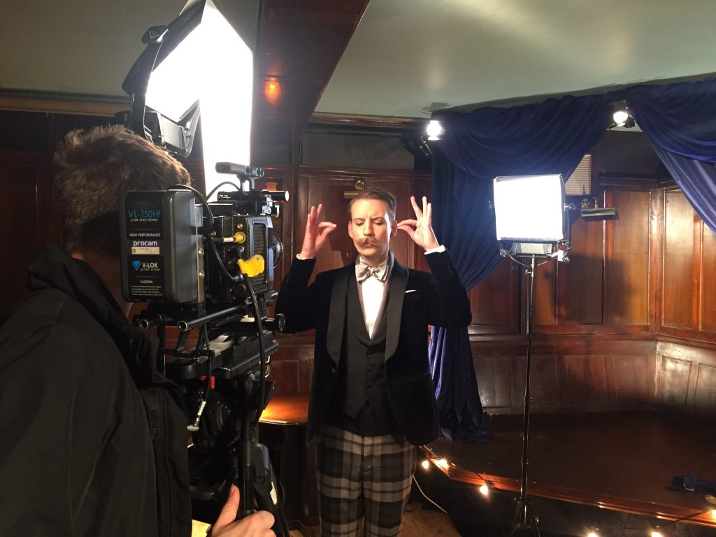 Hackett magician commercial on set