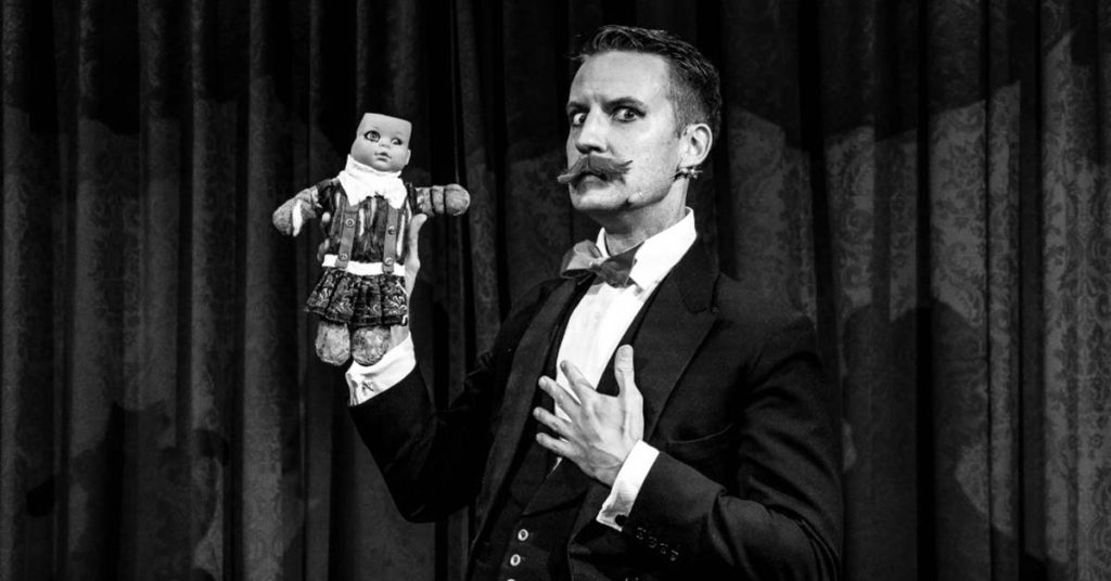 Magic Castle Magician Norvil with a voodoo doll