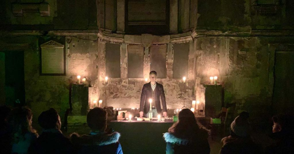 Seance magic show performer in chapel
