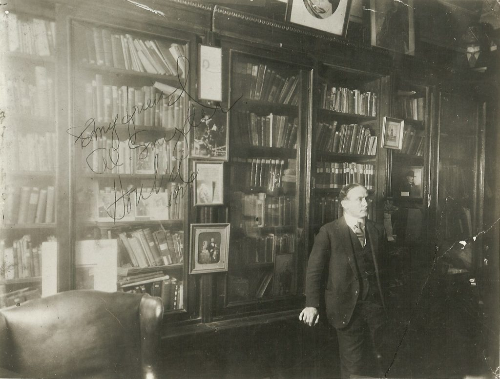 Magician in front of his bookcase
