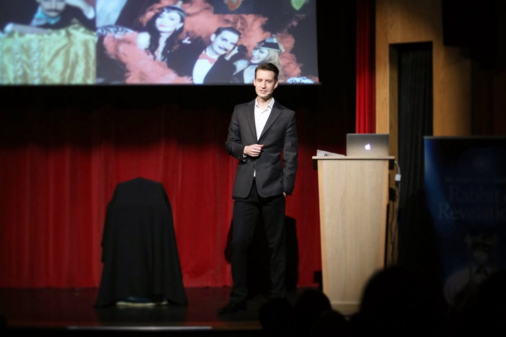 magic circle member gives lecture on stage