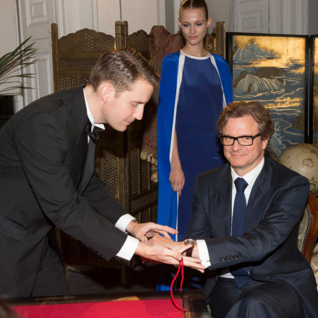 Thumbnail of magician Christopher Howell entertaining Colin Firth