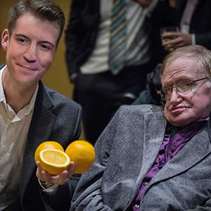 Close-up magician Christopher Howell entertains Professor Stephen Hawking.