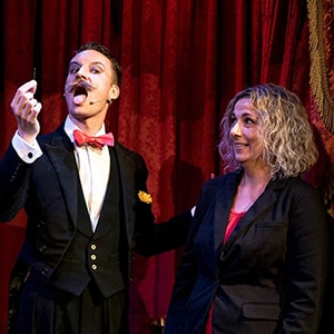 Cabaret magician Norvil performs needle swallowing act.