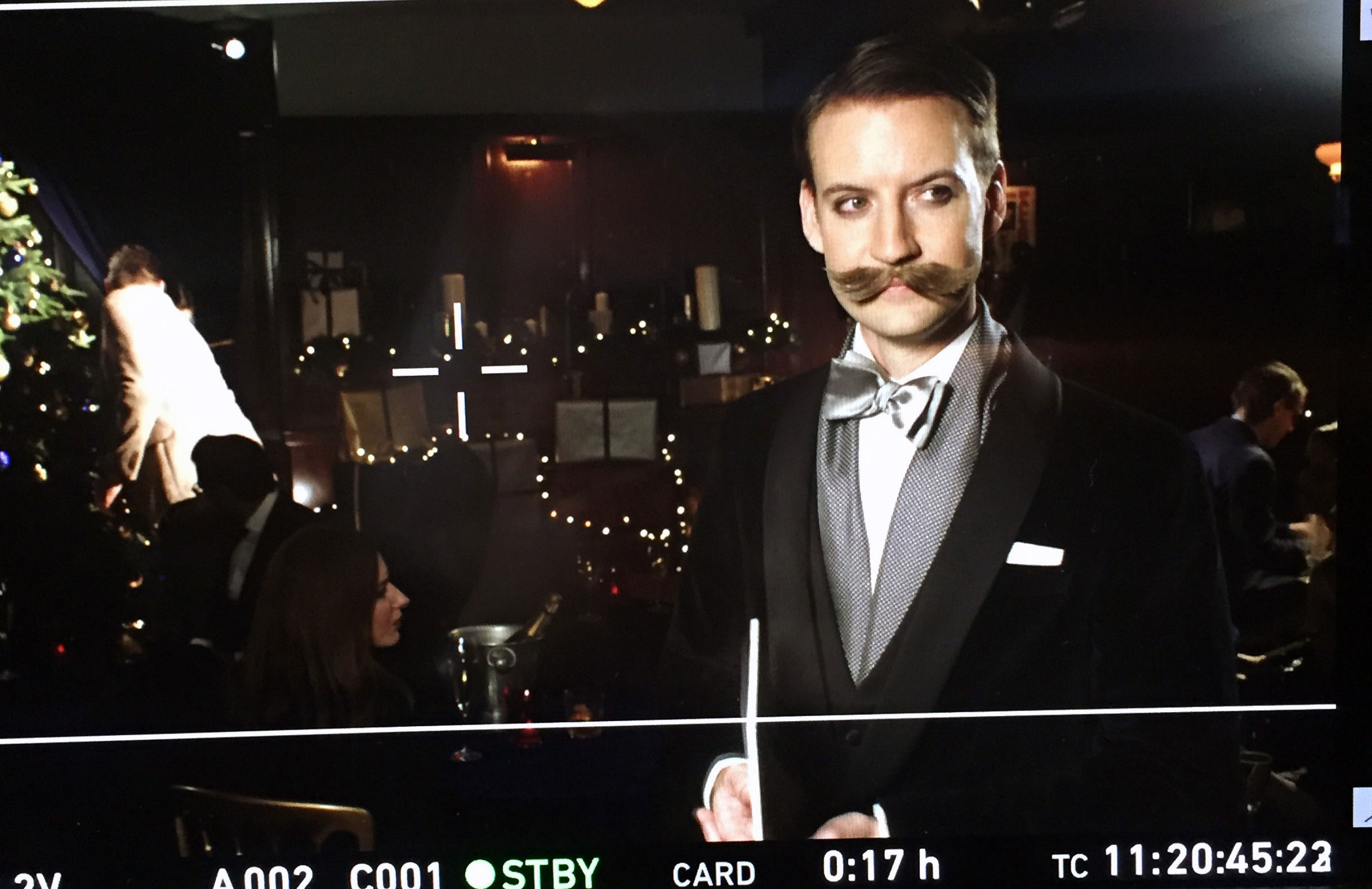 Magician Norvil looks off camera during a screen test of a Hackett Commercial.
