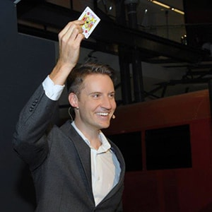 Magician Christopher Howell reveals the card the audience imagined in his Parlour magic show.
