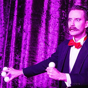 Norvil performs the spirit balls act in his Solo Vaudeville Magic Show.