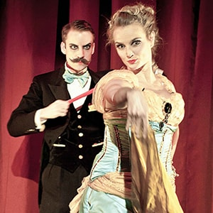 Norvil & Josephine perform their fans waltz act in their Vaudeville double act magic show.